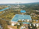 Photo Zoned residential development site in woombye